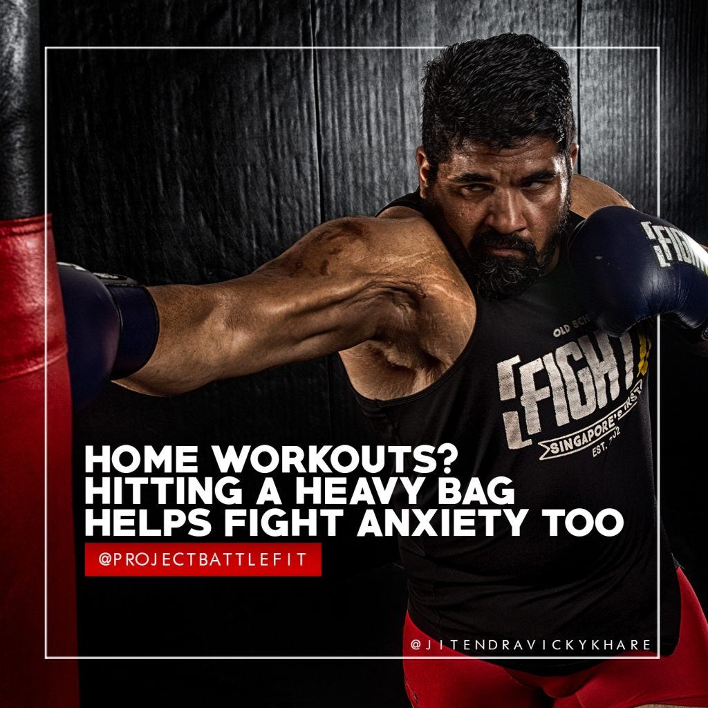 jitendra khare mma head coach tem relentless boxing muay thai on heavy bag shot by fitness photographer pushkraj shirke